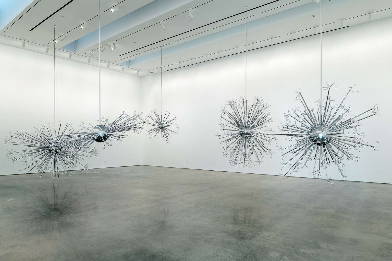 Installation view of Island Universe by Josiah McElheny, 2008. Chrome plated aluminum, handblown and molded glass, electric lighting, and rigging. Dimensions variable. Courtesy the artist. Photo: Nash Baker