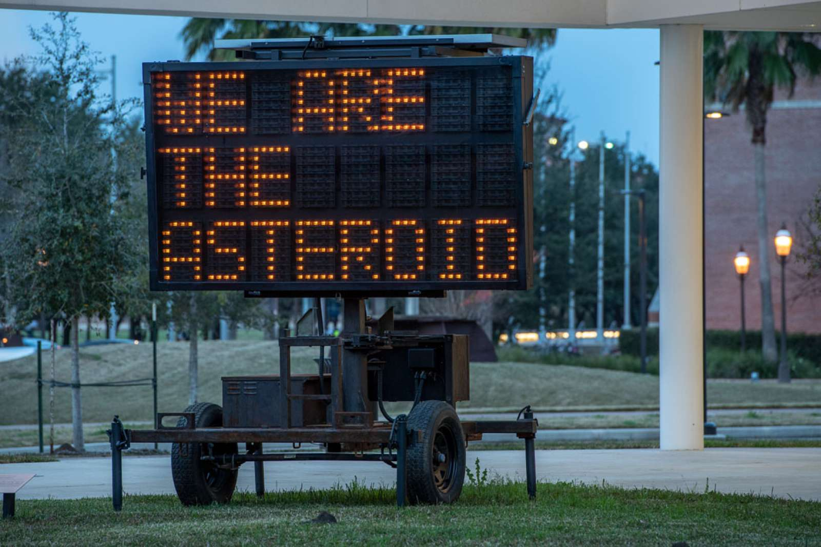 "WE ARE THE ASTEROID III, 2019. Text and sandblasted, solar-powered LED message board. Text by Timothy Morton. Approx. 152"" x 84""/ 386 cm x 213 cm. Photo: courtesy of the artist"