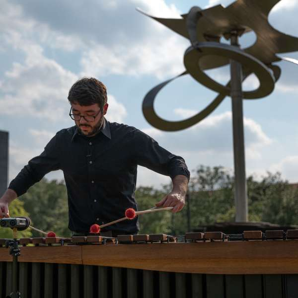 Shepherd School percussionist Aaron Smith performs a new composition by Shepherd School composer Theo Chandler inspired by Mark di Suvero's Po-um (Lyric) (2003). Photo by Daniel Ortiz.