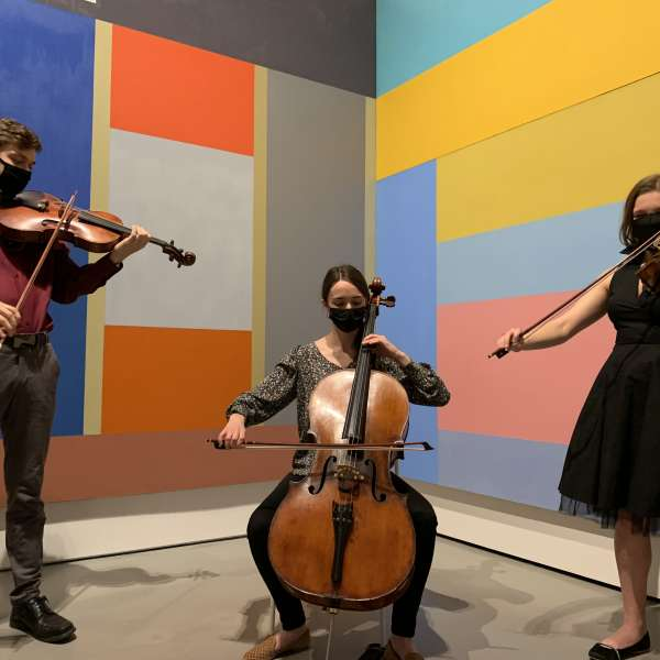 Participating artists in front of works by David Novros. Photo courtesy of Moody Center for the Arts