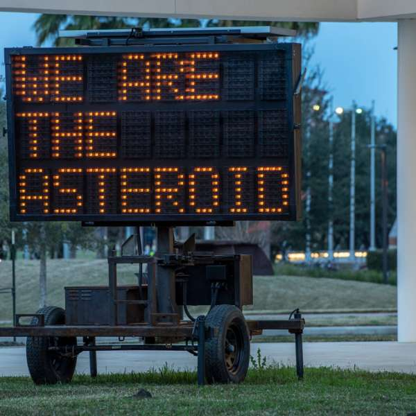 """WE ARE THE ASTEROID III, 2019. Text and sandblasted, solar-powered LED message board. Text by Timothy Morton. Approx. 152"""" x 84""""/ 386 cm x 213 cm. Photo: courtesy of the artist"""